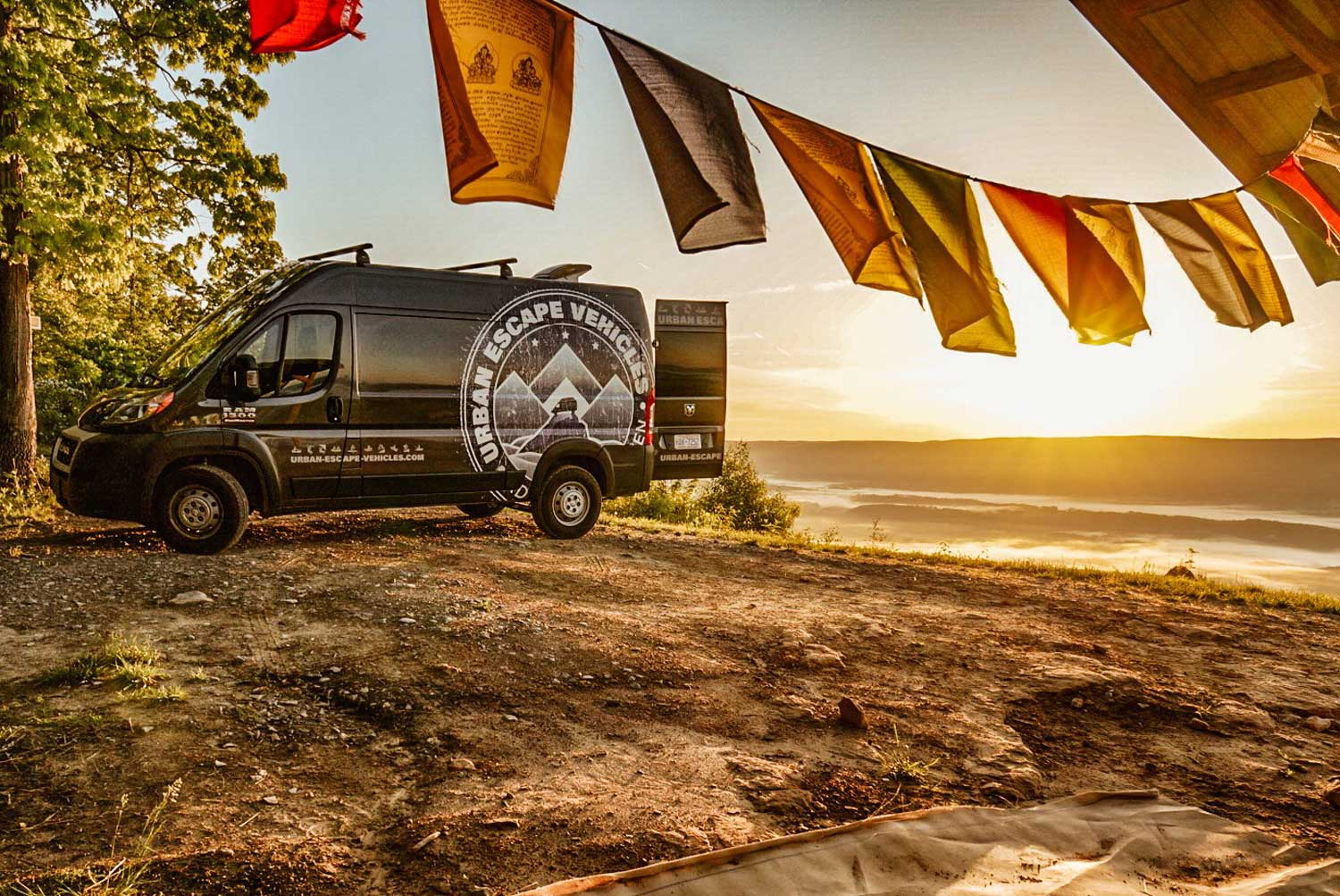 Urban Escape Vehicles Promaster with flags